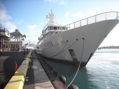 "The ""Musashi"", Larry Ellison's ship at Aloha Tower. The tiny figures on the dock are Wifey and Max."