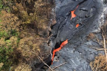 Lava emerges from a new vent in the volcano Kilauea. (Photo credit: Associated Press)