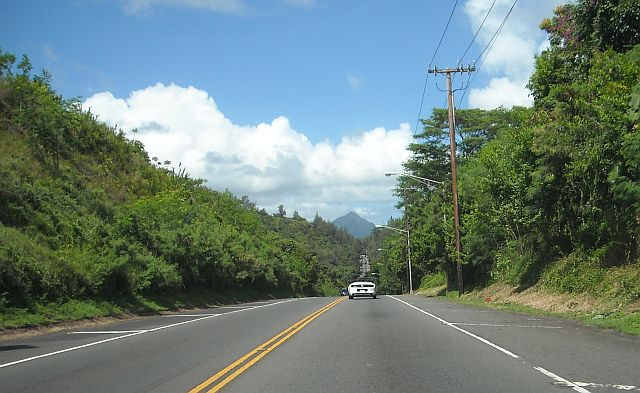 Heading north on Kahekili Highway. The trinagle mountain in the back is Ohulehule which is on a boundary of Kualoa Ranch.