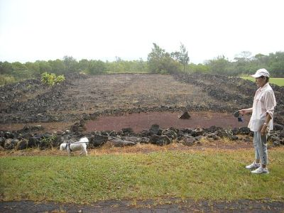 "The flat area in front would have had a 20 foot wooden ""oracle"" tower that would have been the center piece of the heiau."