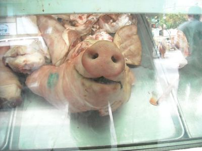 You can buy a whole pig's head in Chinatown. This one looked past its expiration date but seemed surprisingly happy.