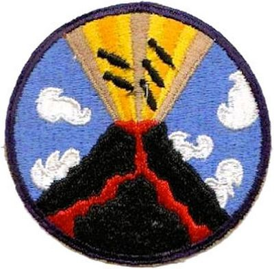 The 23rd Bomb Squadron patch showing the bombs dropping into a volcano. Victory was declared.