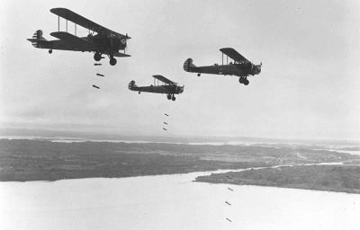 "Practice bomb drop from ""Keystone"" bombers, the last of the Army Air Corp biplane bombers."