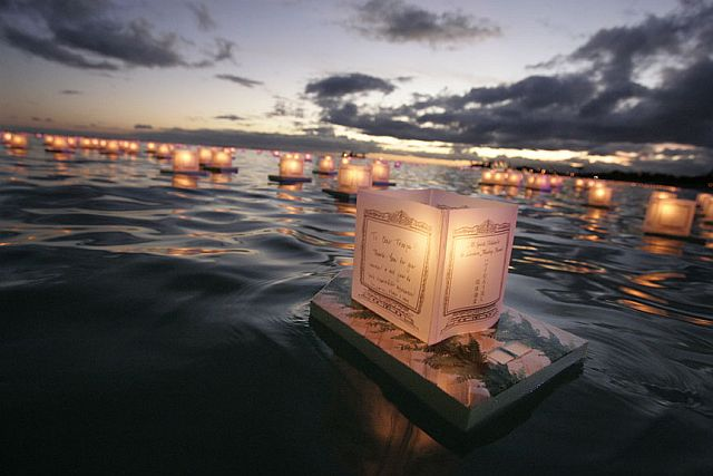 A lantern leaves the shore. Photo credit to Star Bulletin.