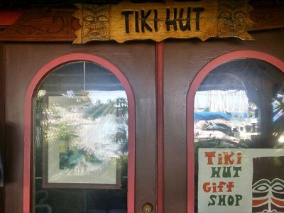 No self-especting Tiki bar would lack a Tiki Hut, source of fine souvenirs with a special focus on ashtrays made from faux-lava and hollow bamboo drink glasses!